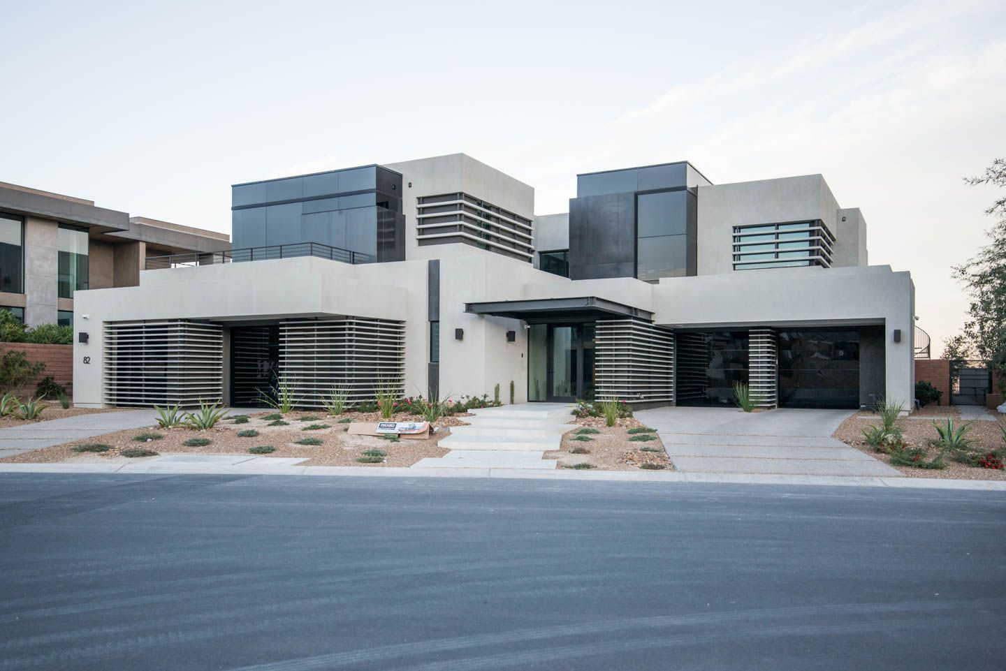 Model 8450 luminous glass garage doors on this very modern home model 8450 luminous glass garage doors on this very modern home in las vegas eventelaan Image collections