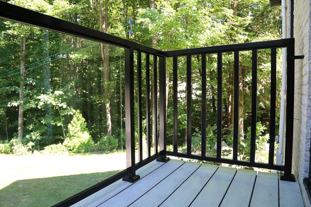 Black aluminum railing with large glass panels diy
