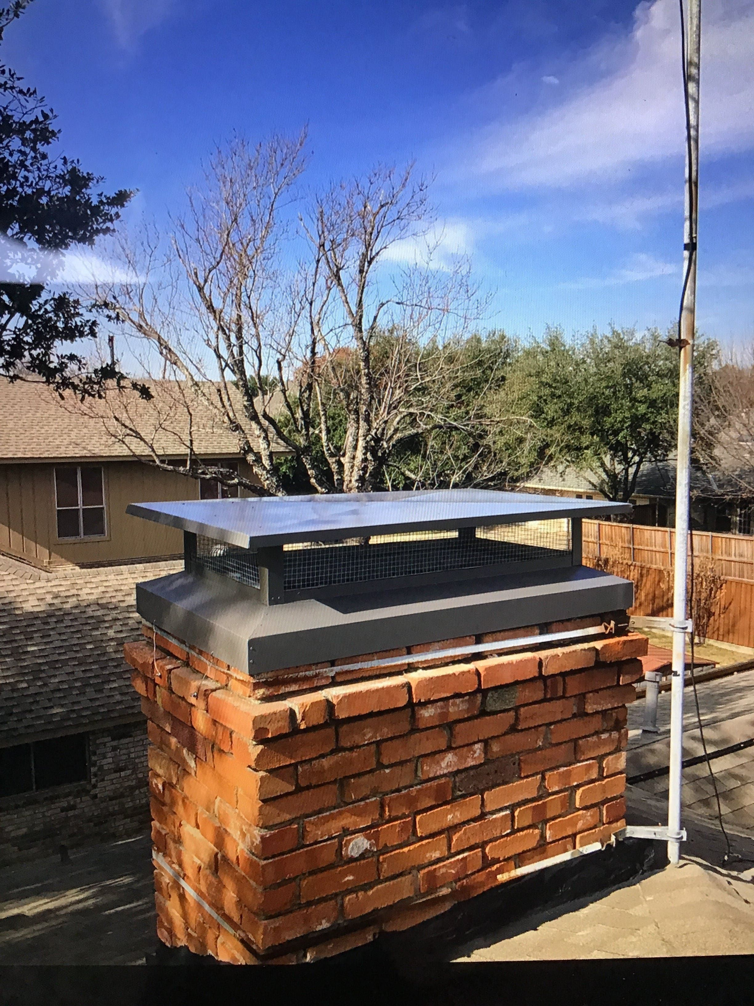 Grey chimney cap made by master services installed in