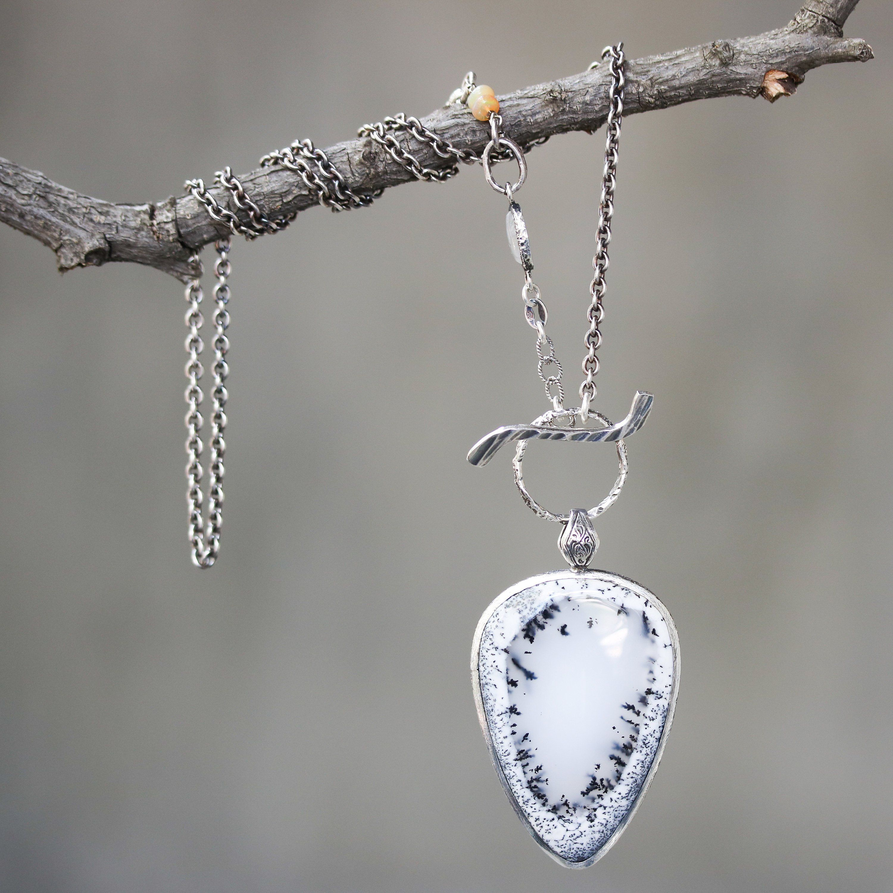 Teardrop moss agate pendant necklace in silver bezel setting with