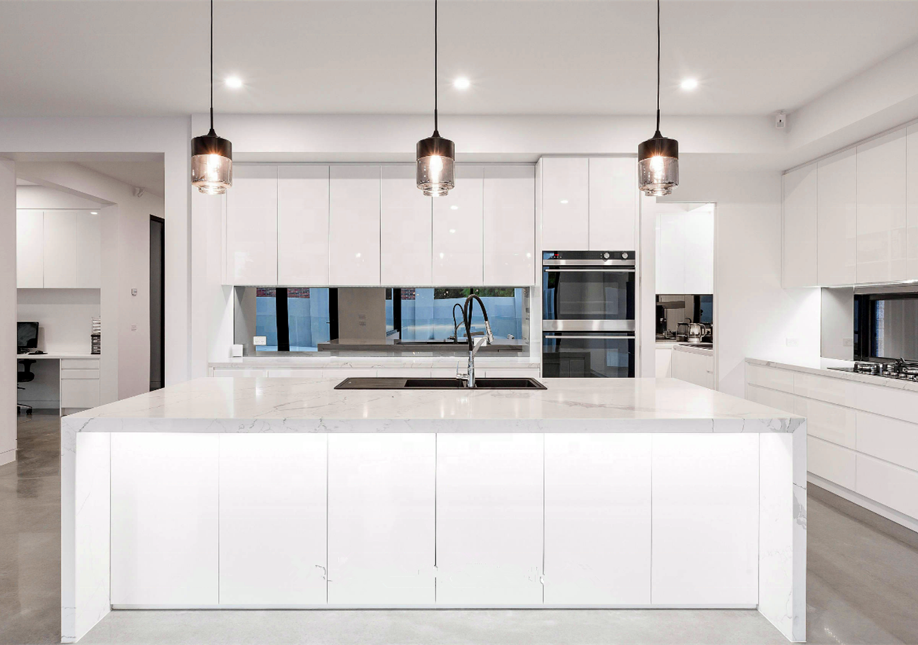 Modern White Kitchen With Waterfall Island White Modern Kitchen Kitchen Cabinet Design Modern Kitchen Cabinets