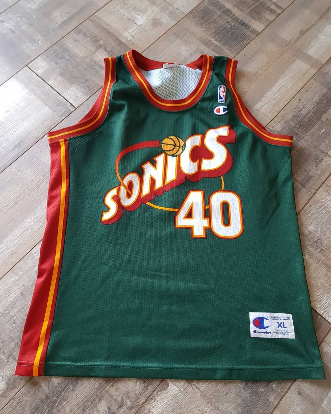 """34f79eede """"Shawn Kemp Seattle Supersonics Jersey (fits like a large). £50 + shipping.   OPEN TO OFFERS  🏀🔥. . This Champion Jersey is in…"""""""