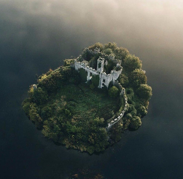 McDermott's Castle, Ireland.   I always find it so beautiful when nature takes over abandoned places.