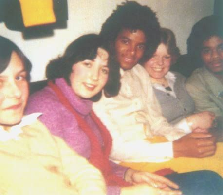 Michael Jackson in the Motown era backstage with fans.