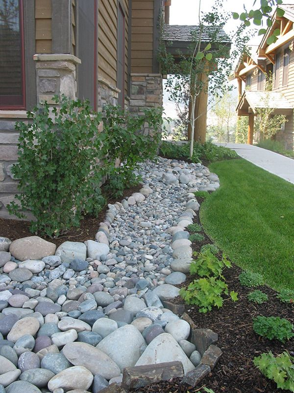 Lovely dry river stream bed picture ideas garden dry for River rock yard ideas