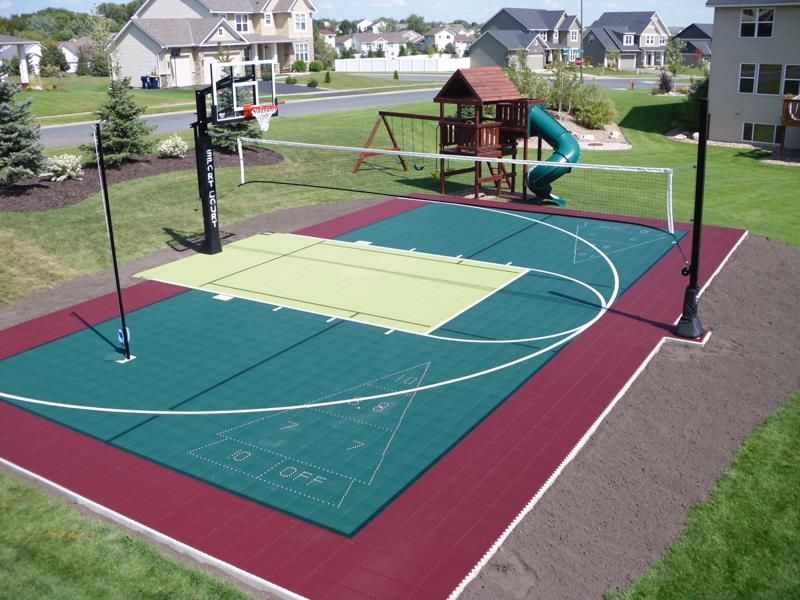 A multi sport residential backyard game court is the for Backyard sport court