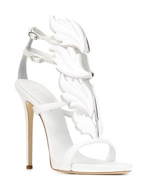 2994517111b66 Giuseppe Zanotti's Cruel Sandal in white. A scene-stealing Italian sandal  in an iconic