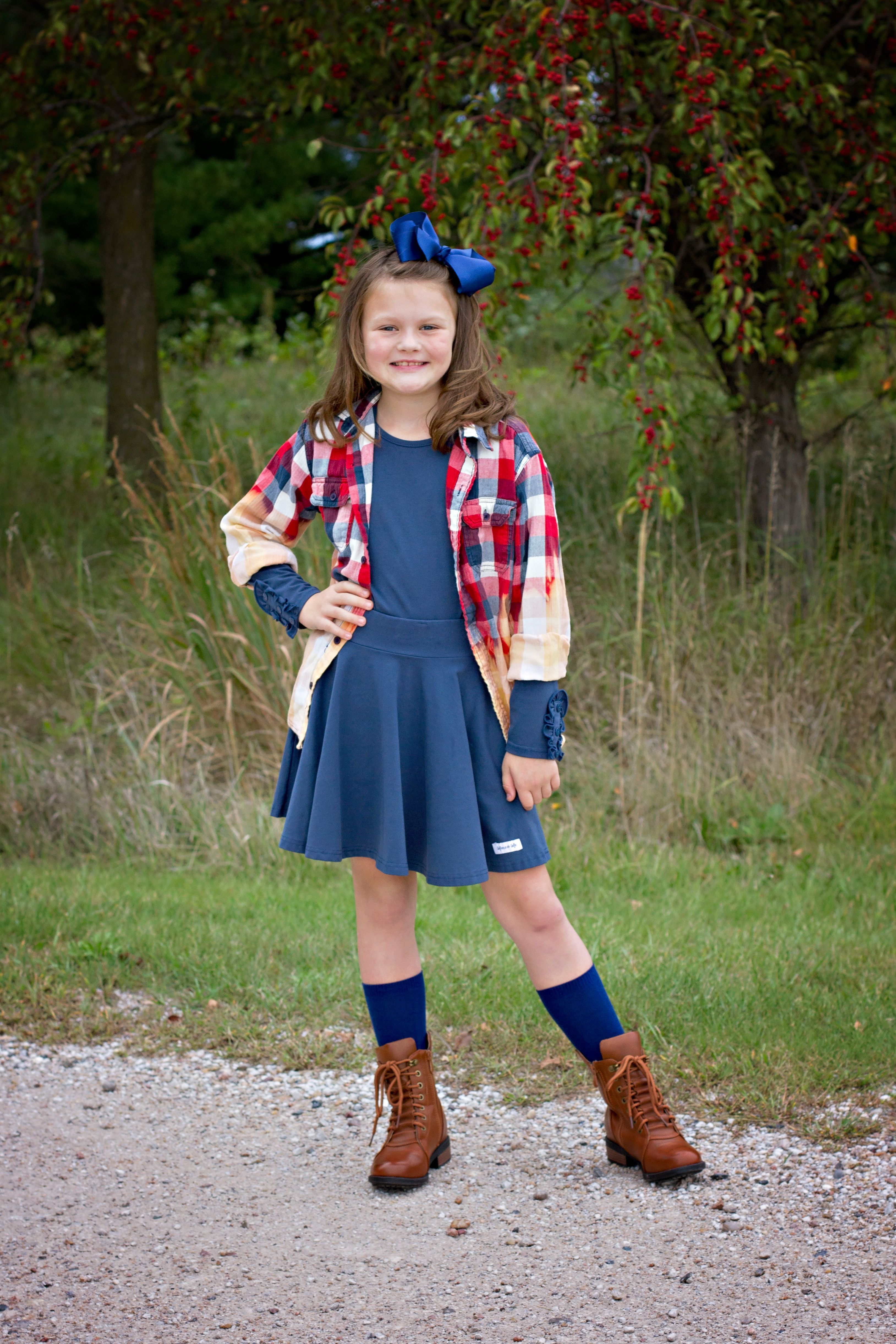 Plaid + Twirl Skirt #twirlskirt Loving this pop of color layered over #merceandme Bettie Buttons top and matching navy twirl skirt.  So good for fall! #tweenfashion #twirlskirt #plaid #distressedplaid #fallfaahion #navy #twirlskirt Plaid + Twirl Skirt #twirlskirt Loving this pop of color layered over #merceandme Bettie Buttons top and matching navy twirl skirt.  So good for fall! #tweenfashion #twirlskirt #plaid #distressedplaid #fallfaahion #navy #twirlskirt Plaid + Twirl Skirt #twirlskirt Lovi #twirlskirt