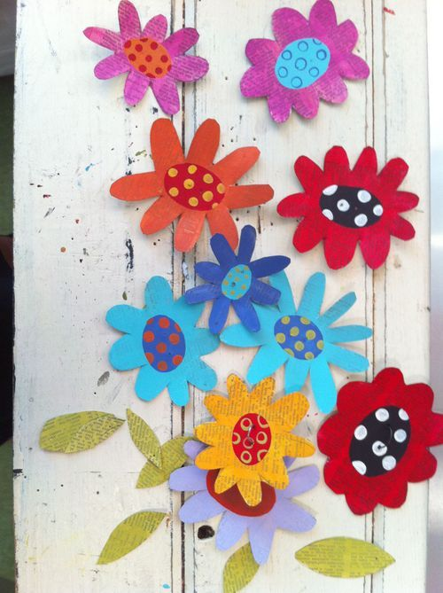 paper flowers made out of vintage text and metal...painted with acrylics!