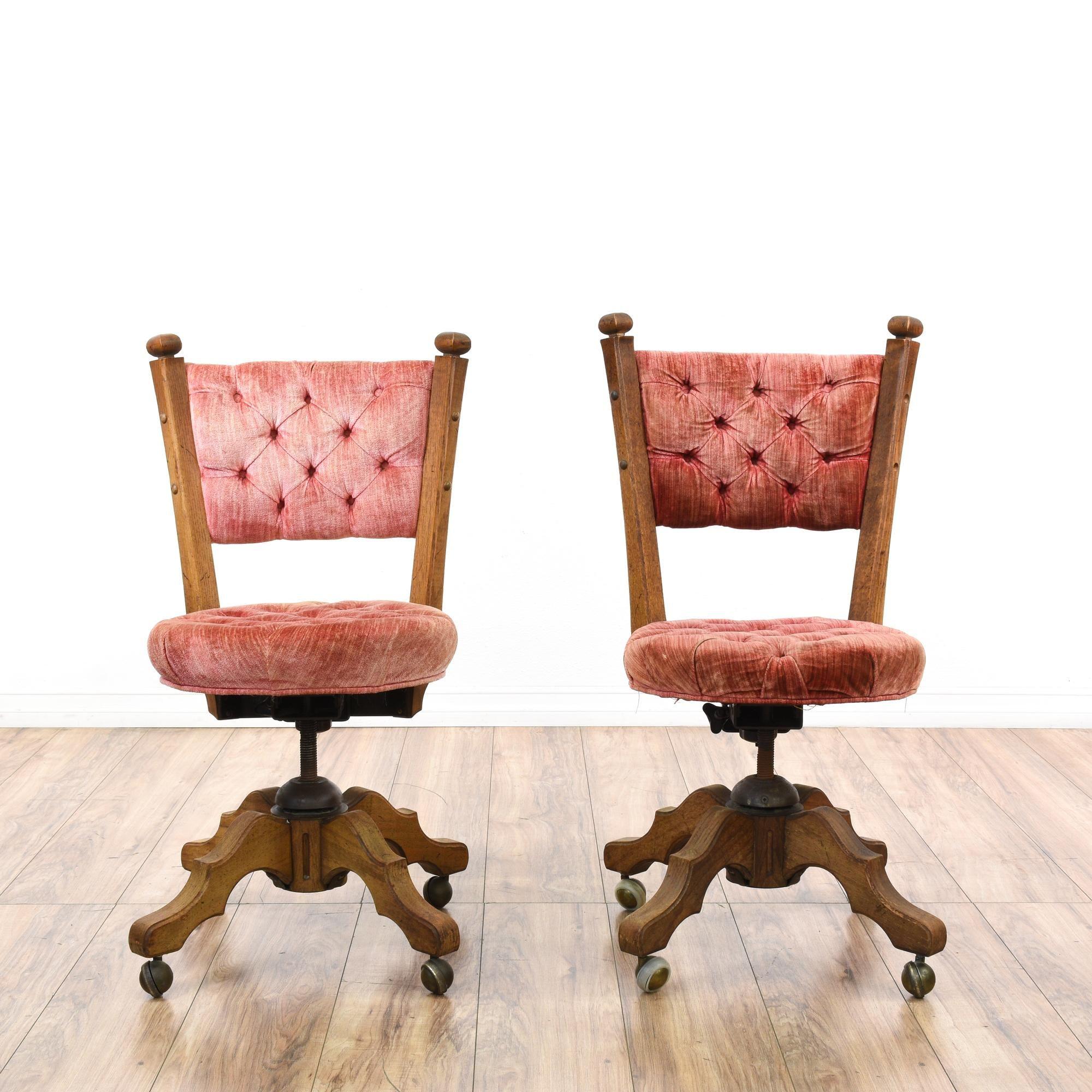 pair of pink velvet tufted wood swivel chairs | pink velvet