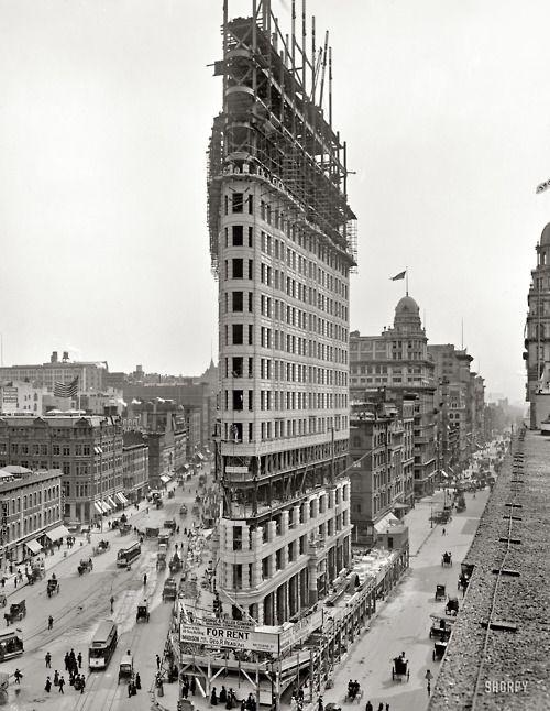 Flatiron Building under construction, New York City, USA, 1902.    Architect: D.H. Burnham & Co.