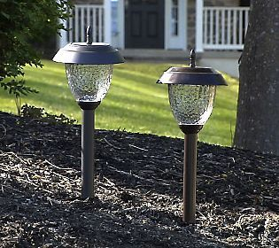 Safety First Along With Beautiful Patterns Of Light With These 8 Pc Solar Light Set For Your Walkway Or Patio Outdoor Style Solar Lights Front Courtyard