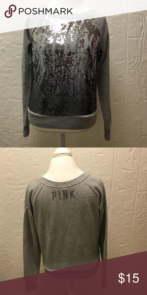 Gray Sequin Sweatshirt Victoria's Secret Pink wide neck sweatshirt with sequins. PINK is spelled out on the chest not having any sequins. In great condition. Sequins are in an ombré pattern. There are a couple spots where sequins have come off, but no large missing spots and nothing noticeable. Victoria's Secret Tops Sweatshirts & Hoodies
