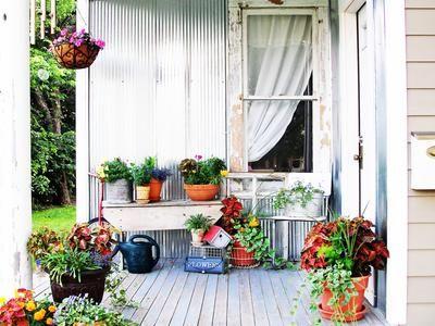I'm a sucker for porches!  This one's pretty darn inviting!