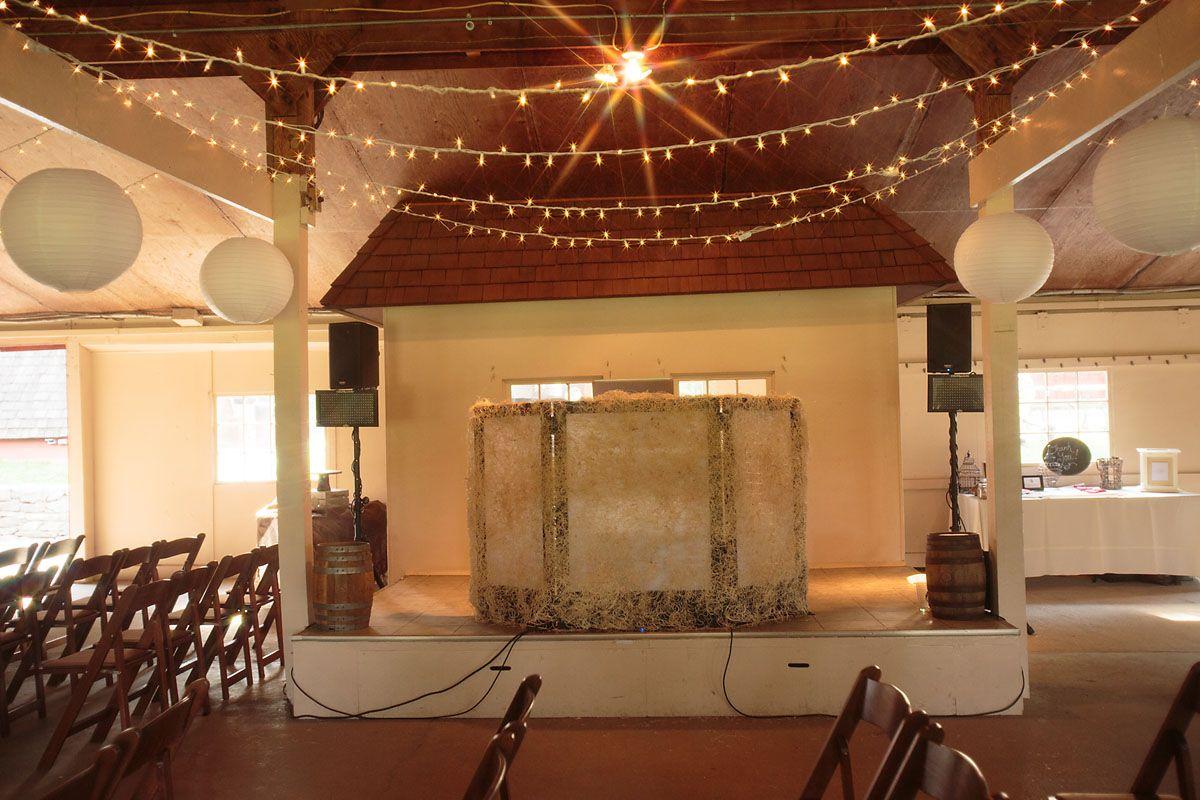 #wedding #venue #lighting #stage #DJbooth #stringlights #roundlanterns Jason Weil Photography