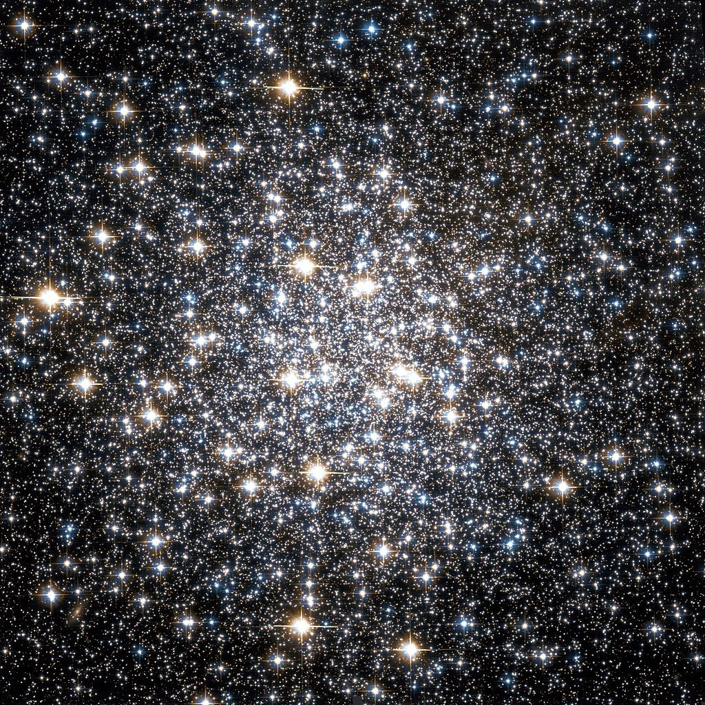Messier 10 (also known as M10 or NGC 6254) is a globular cluster of stars in the equatorial constellation of Ophiuchus.  It has a spatial diameter of 83 light-years and is estimated to be 14,300 light-years away. The cluster is currently located about  (16 kly) from the Galactic Center. It completes an orbit around the Milky Way galaxy about every 140 million years, during which it crosses the plane of the galactic disk every 53 million years. Its rosette orbit has an eccentricity of 0.21.