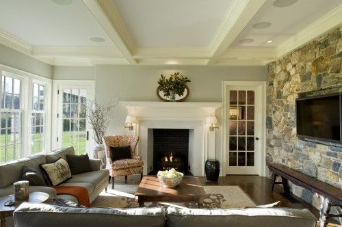 fantastic sunroom - stone wall, wall of windows, glass door, and fireplace