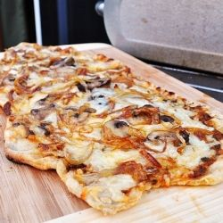 Pizza on the Grill - once you try it, you will never cook it in the oven again! It really is delicious and easy.