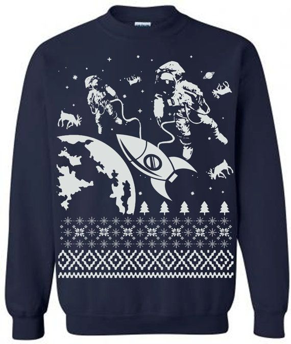 d44eb799 Astronauts in outer space saving the lost reindeer ugly sweater. Super  comfy and soft fleece that keeps you warm and extra stylish. Unlike typical