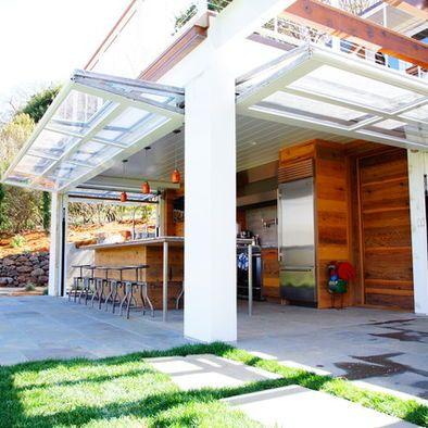 Indoor Outdoor Room With Glass Bi Fold Hangar Doors Modern