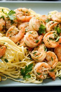 This classic recipe makes a simple garlic, white wine and butter sauce that goes well with a pile of pasta or with a hunk of crusty bread. However you make the dish, once the shrimp are added to the pan, the trick is to cook them just long enough that they turn pink all over, but not until their bodies curl into rounds with the texture of tires. (Photo: Craig Lee for The New York Times) #shrimpscampi