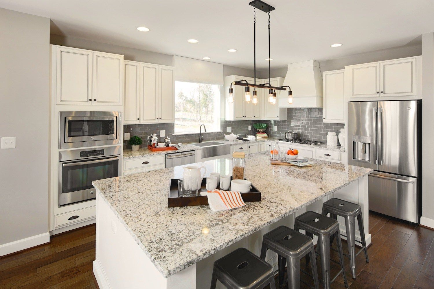 Beautiful white and gray kitchen with granite countertops