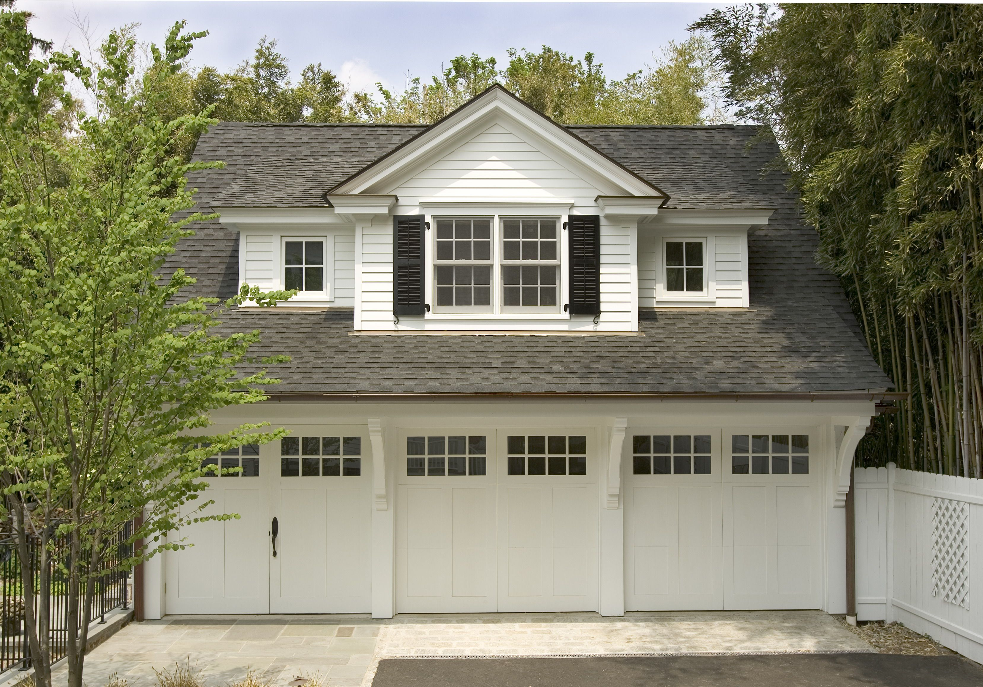 This Carriage House With Lots Of Charm And Detail Has Three Car Bays A Pool Changing Area And Inclu Above Garage Apartment Carriage House Garage Garage Design