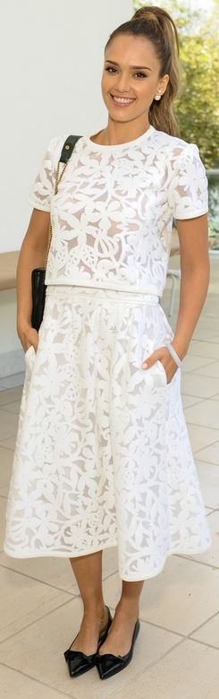 Who made Jessica Alba's black handbag, floral tee, and white flare skirt that she wore in Los Angeles?