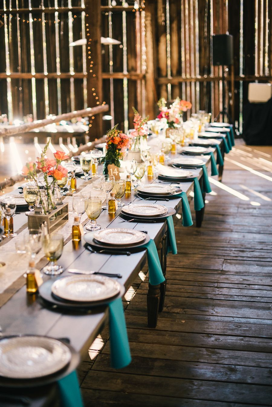 Barn Reception - Bright & Beautiful - Photography:  kenkienow.com on #SMP. See the wedding here: http://www.StyleMePretty.com/california-weddings/sacramento/2014/03/29/colorful-squirrel-creek-ranch-wedding/