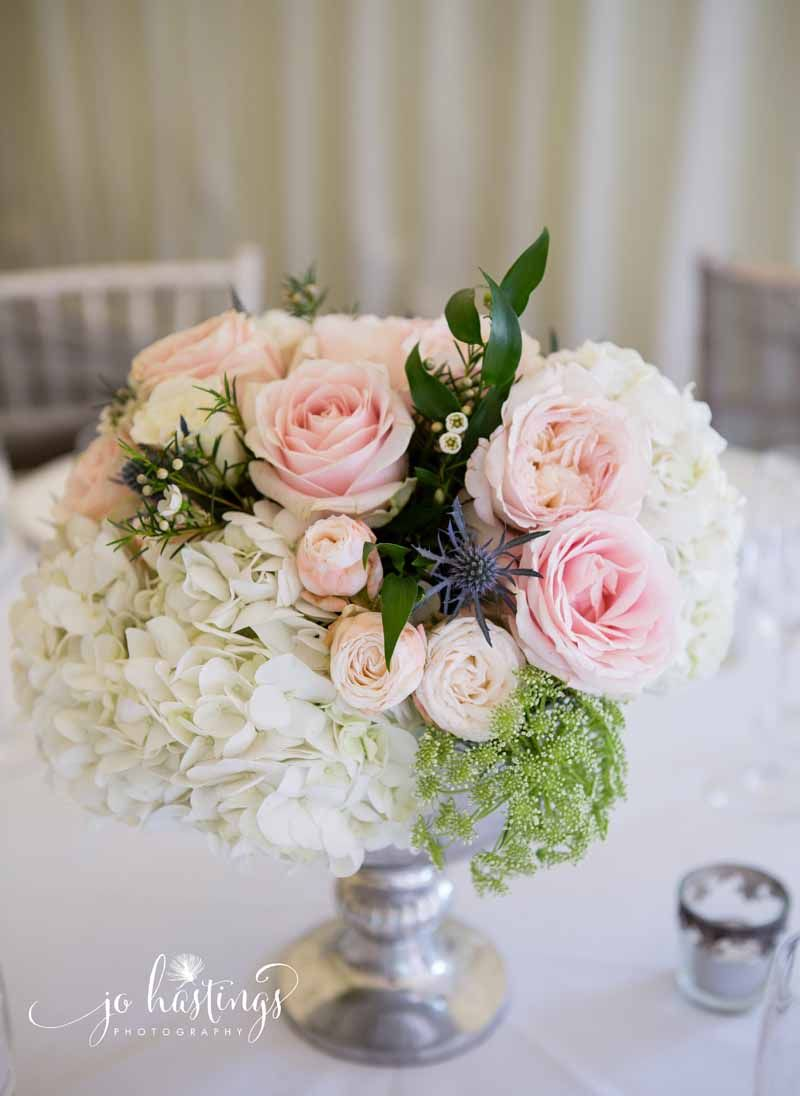 Blush pink roses and dusty blue thistles wedding