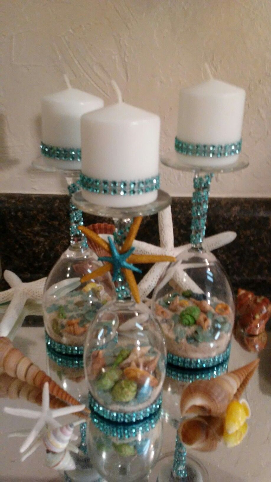 Upside down wine glass candle holders. Lots of shells
