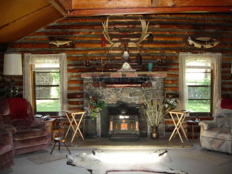 Log Cabin Decorating Ideas With Wall Decor And Stove Design Pictures