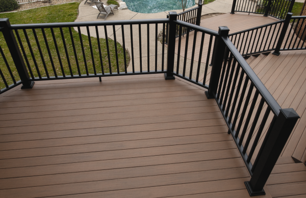 Deck inspiration stained deck with black railing home for Best material for deck
