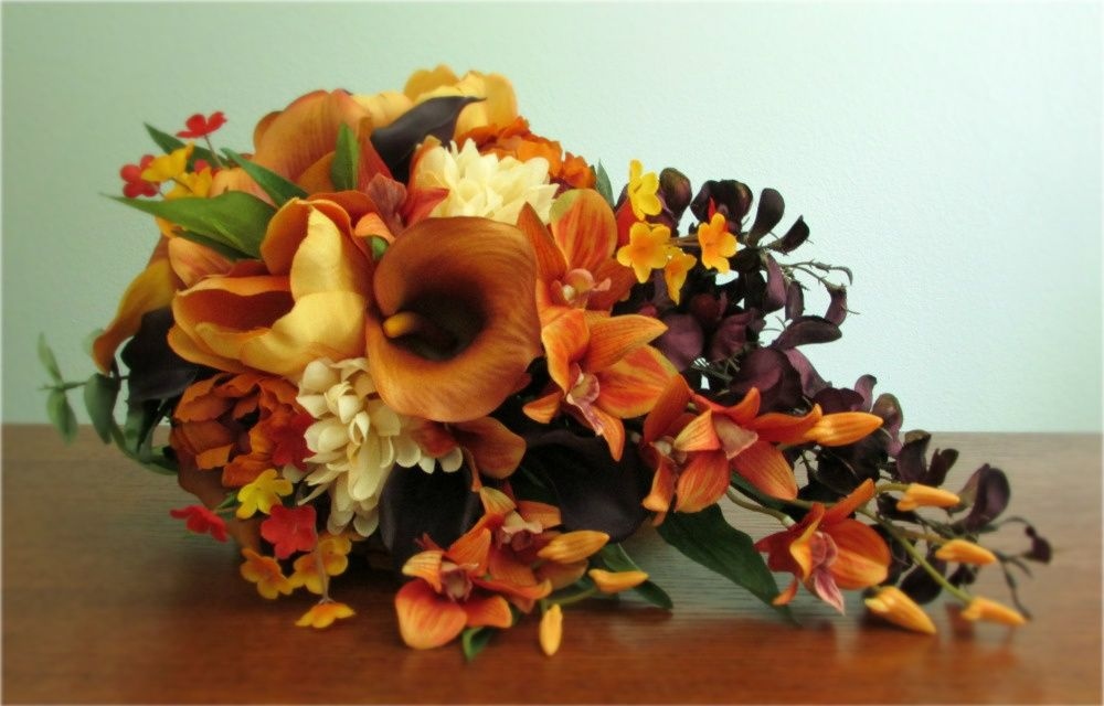 "Custom version of my ""Sunset"" Bouquet with the addition of eggplant colored mini calla lilies and wisteria."