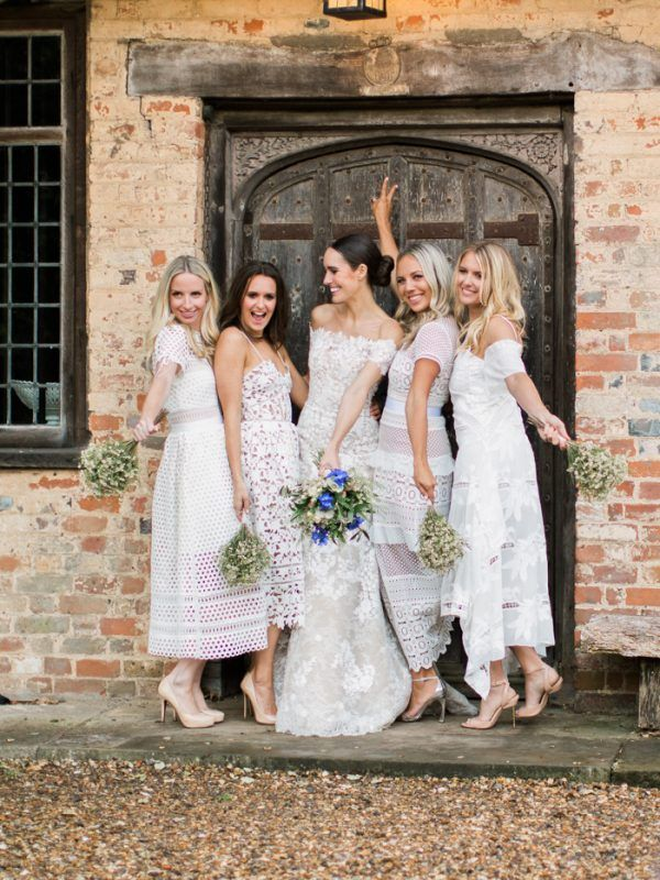 White and ivory bridesmaids dresses have been breaking tradition for the last couple of years, but we can't get enough of the white lace bridesmaids dresses we're seeing in 2017! | Image by Amy Fanton Photography