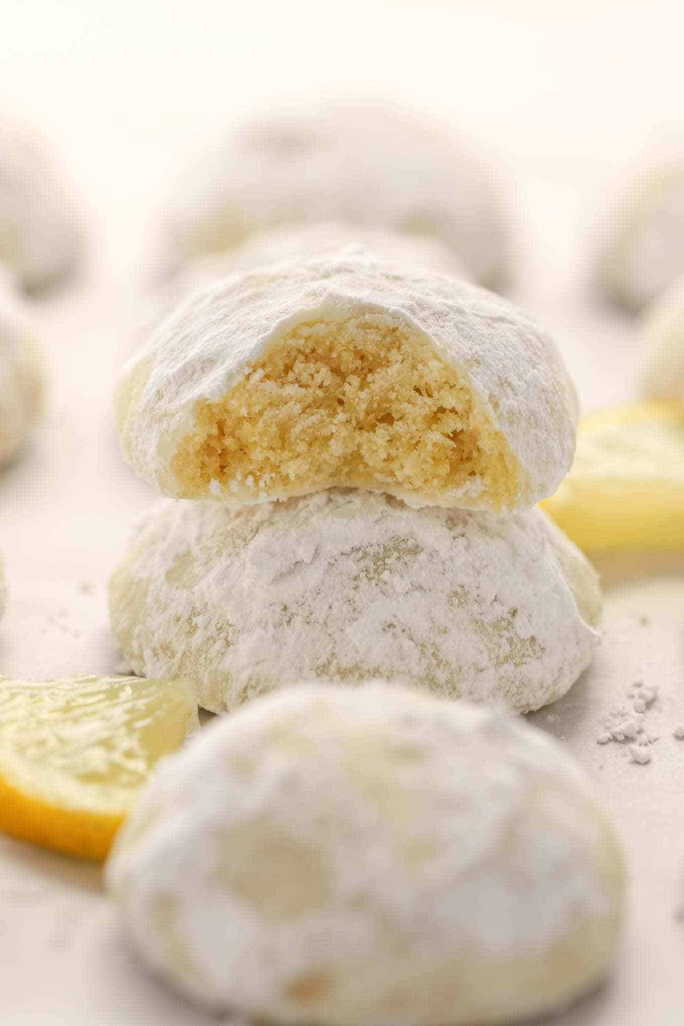 Buttery And Tender Lemon Cookies Rolled In Powdered Sugar These