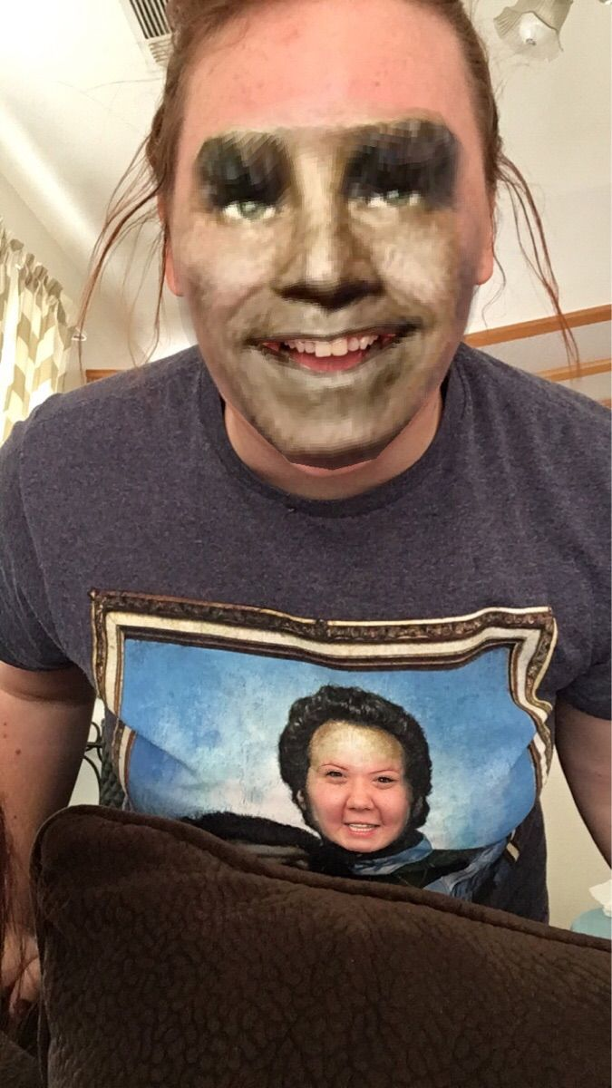 My friend played with snapchat's face swap filter while wearing her