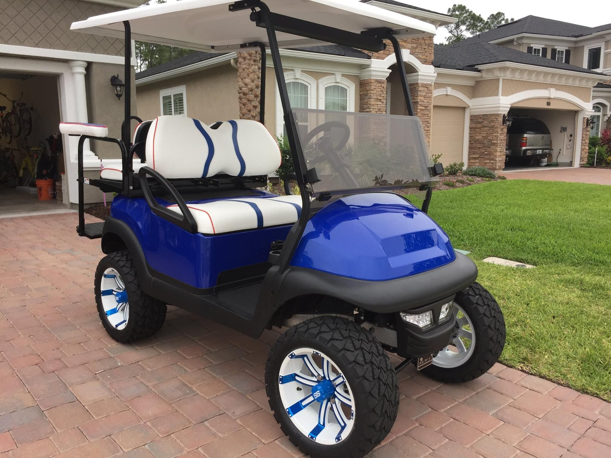 Royal Blue Club Car Precedent Golf Cart With Custom White And Blue Wheels And Seating Golf Carts Club Car Golf Cart Golf Cart Windshield