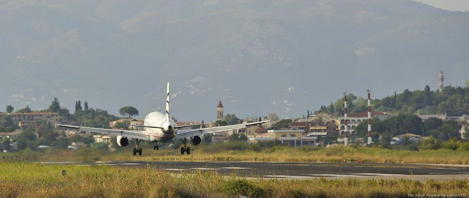 AEGEAN Late in the afternoon of a day of August in Corfu Ioannis Kapodistrias (Capodistrias) International Airport (IATA: CFU, ICAO: LGKR)