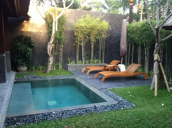 Inground Pool Ideas Small Yards fiberglass inground pool with small stoned wall and small waterfalls installed 18 Gorgeous Backyard Swimming Pools With Small Sizes For Everyones Taste