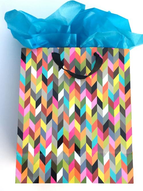 5 Creative Ways to Entertain Your Clients — One Strange Bird bag gift