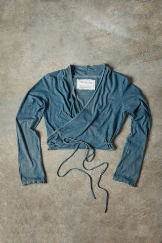 "Our 100% organic medium-weight A. Chanin Wrap Cardigan is machine-sewn in-house. Wraps and ties just below the bust, accentuating the waist for a flattering fit. Measures 16"" from the shoulder. Choose your size and color below. Shown here in Blue Grey. Hand dyed to order. Please allow three weeks for delivery. Made in the USA."