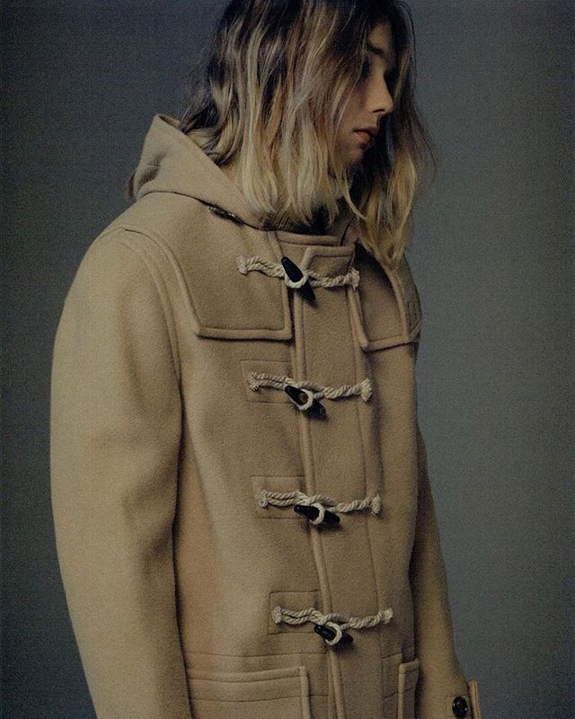 A beige duffel coat from the Maison Margiela Men's AW16 Collection takes the spotlight in @uomo_magazine's November issue. Photographed by Shunya Arial and styled by Tsuyoshi Noguchi. #maisonmargiela