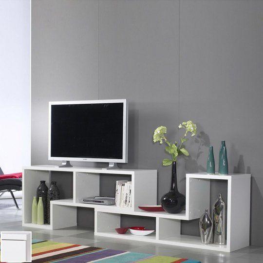 Weer eens wat anders dan een gewoon tv meubel. Hmmm lijkt me ook nog wel te maken van een boekenkast met 2 stukken zijkanten eruit te zagen......