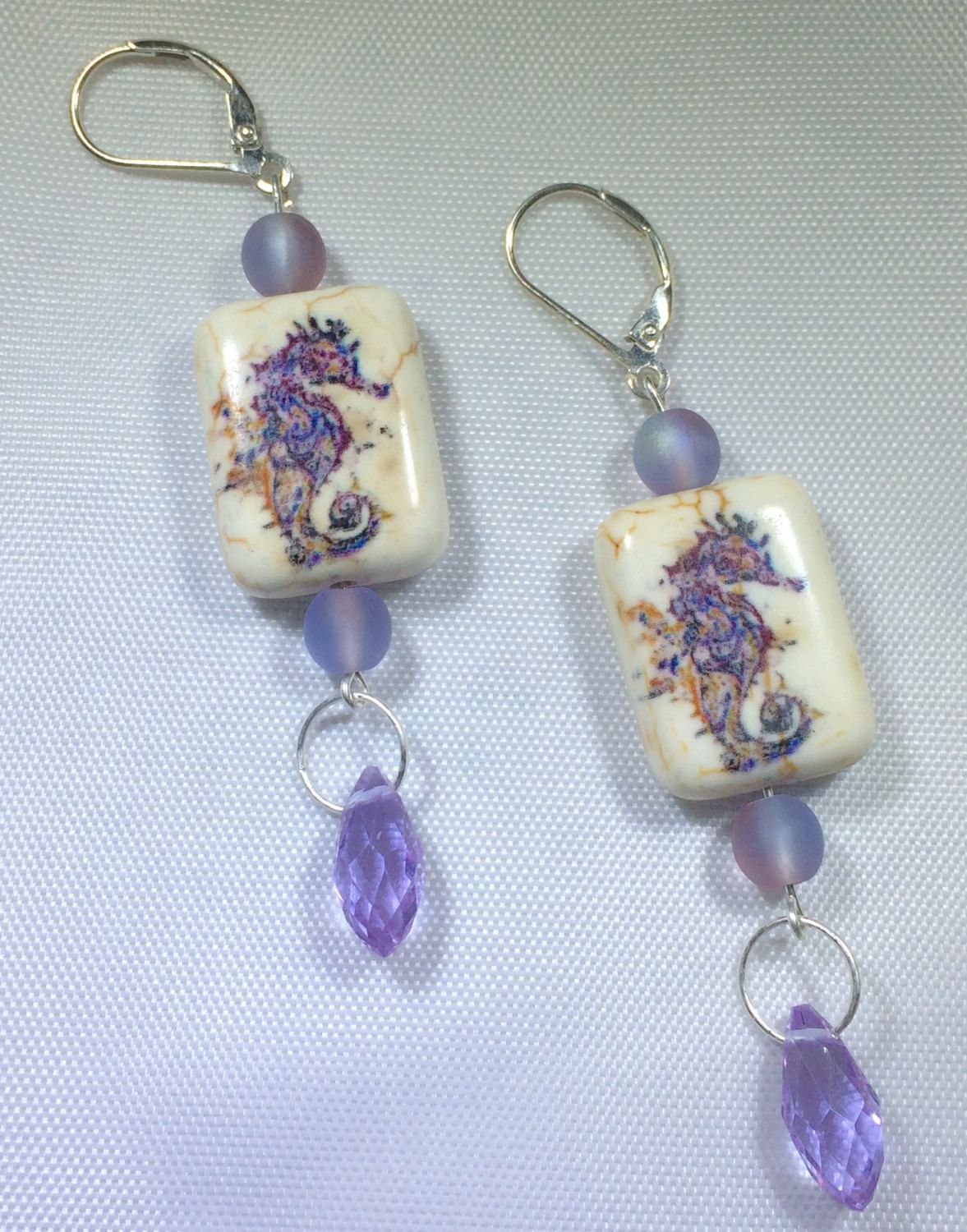 Handmade purple and white ceramic starfish silver earrings with purple briolette crystals.  Perfect for a cruise, vacation or anytime! by RideTheWindDesigns on Etsy