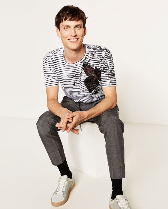 Image 1 of STRIPED T-SHIRT WITH PATCHES from Zara