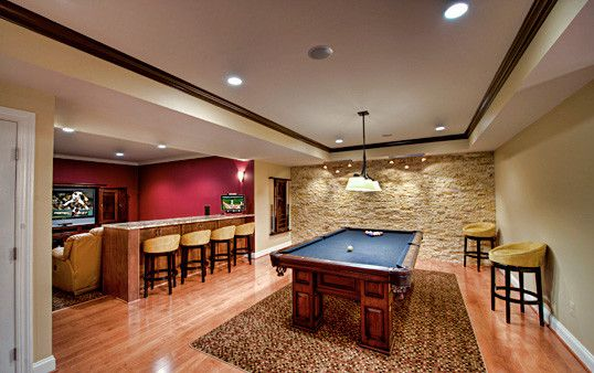 games room with bar bar seating basement bold color contemporary