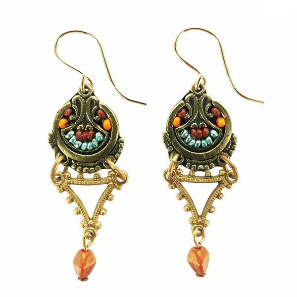 Rust Topaz, Turquoise, Red Jasper gemstones and Austrian crystals on antiqued brass comprise this richly colored well designed drop earrings. Designed and created by Ann Egan. Artisan handmade in the USA.