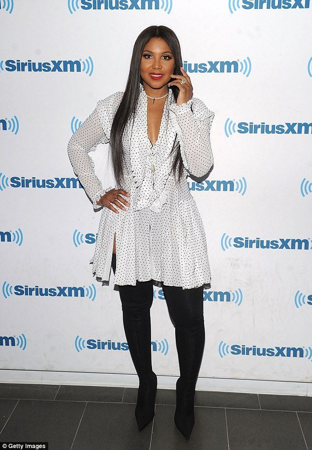 Photo of Toni Braxton puts on sexy display in plunging shirt dress