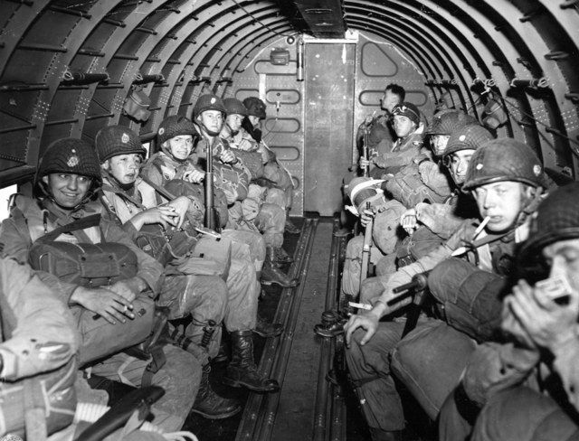 WWII 1944. #82nd #Airborne paratroopers [#Fort #Bragg, #NC]  fly over the English Channel en route to play a key role in the invasion of France by landing along a 100 mile front of the Normandy coast. [AP-US Signal Corps] fayobserver.com/ qw